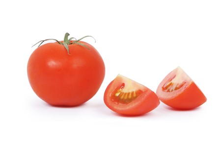 Tomatoes, one whole and two parts. Isolated on white. Stock Photo