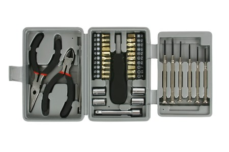 Toolkit with screwdrivers, pliers, wrenches and tweezers. Isolated on white.