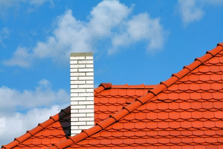 chimneys: new red roof Stock Photo