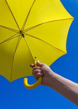 yellow umbrella: yellow umbrella under blue sky Stock Photo