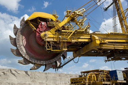 Giant excavator in open-cast coal mine  photo