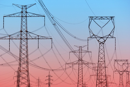 Power lines on evening sky Stock Photo - 12964158