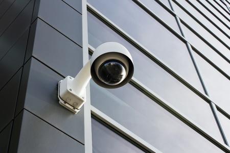 Security camera on modern building facade photo