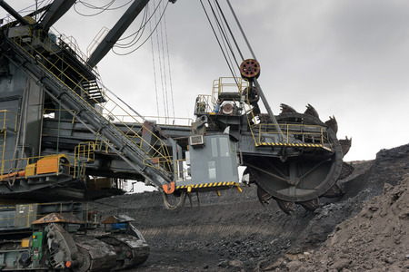 Coal mining in rainy day photo