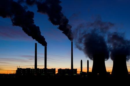 Coal power plant under evening sky photo