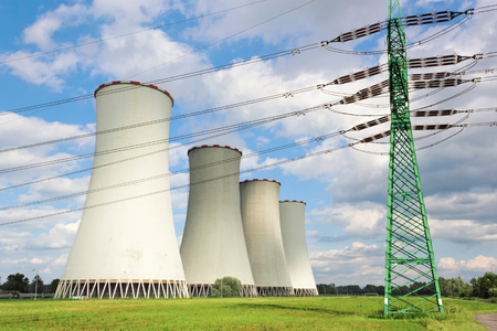 exhalation: High-voltage line in front of cooling towers Stock Photo