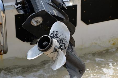 benzine: engine of motor boat close-up detail photo