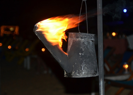 flaming torch: flaming torch created from watering can photography