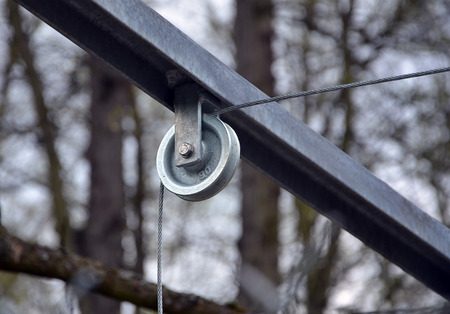 transom: photo of metal pulley and steel rope Stock Photo