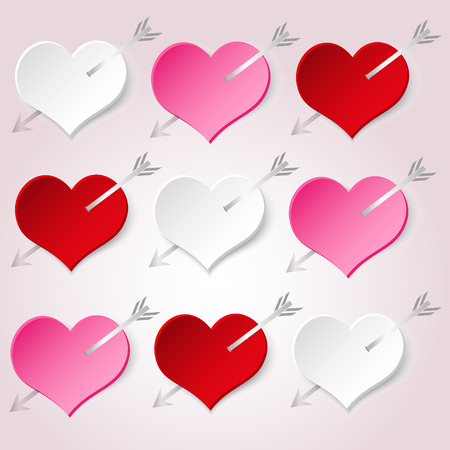 stabbed: white red and pink valentine hearths with arrow from paper decoration element eps10