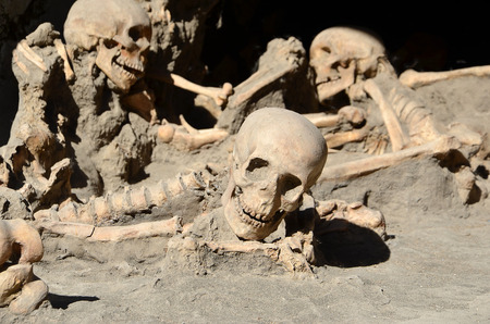 burried: skulls of long time ago dead men in the ruins of Ercolano Italy