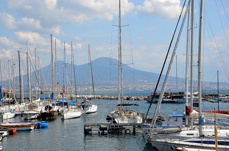 wrack: city harbor for sails in Naples with vesuvius in background