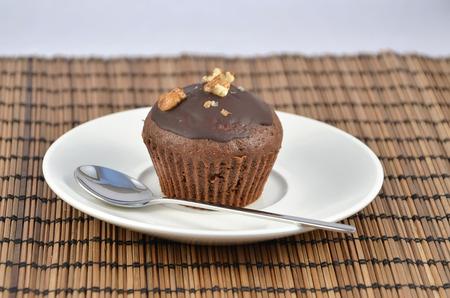 one chocolate brown muffins on white plate best dessert