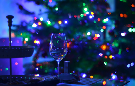 empty wine glass and abstact night blury defocus bokeh light background photography