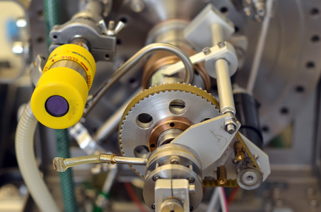 detail of parts of laboratory machine with gear Stock Photo