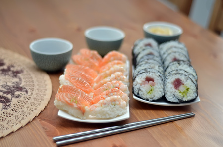 two plate of maki sushi rolls and nigiri sushi with salmon and shrimp japan food on the table with soy sauce Stock Photo