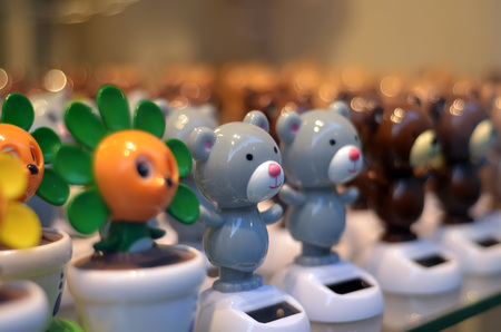 pannel: detail of bear and flower moving toys with solar pannels Stock Photo