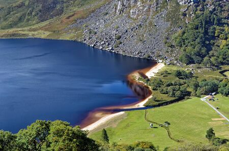 detail Lough Tay dark lake top view at Wicklow Ireland