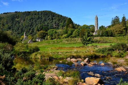 landscape with old celtic round tower in Glendalough 版權商用圖片