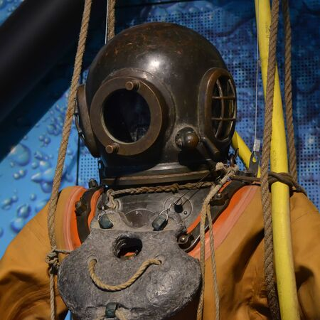 detail of old diving suit with metal helmet