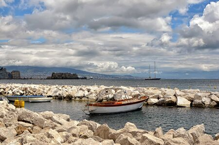 small boat and landscape with castle in Naples photography