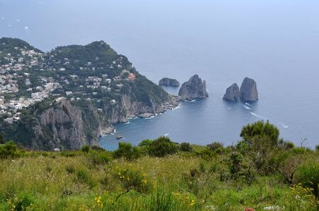 rocks in the water from distance and nature Capri island in Italy photo