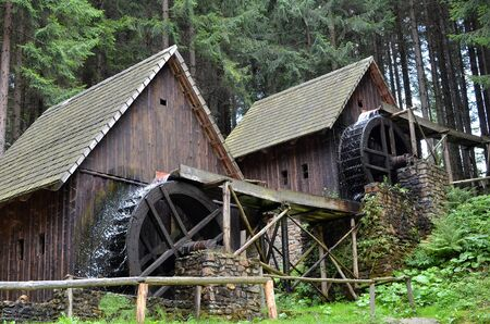 two old wooden water mill with mill-wheel detail photo 版權商用圖片