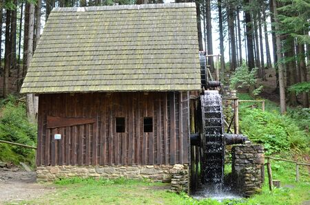 old wooden water mill with mill-wheel detail photo 版權商用圖片