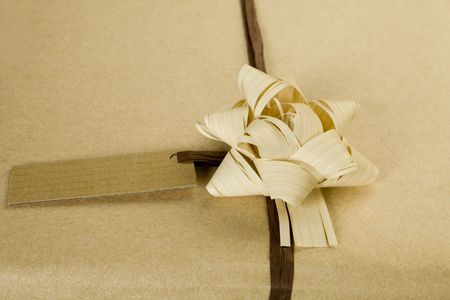 Beautifully naturally wrapped gift with name tag. photo