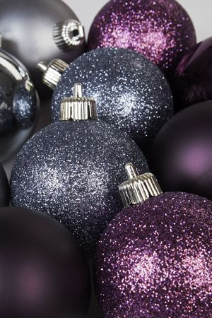Silver and purple shiny and mat christmas balls. photo