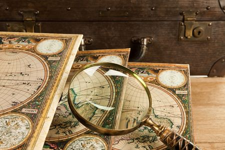 Travelling set - Retro suitcase, magnifier and world map. photo