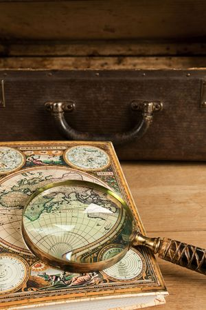 Travelling set - Vintage suitcase, magnifier and world map. Stock Photo - 8157561