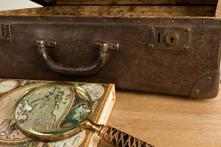 Travelling set - Antigue suitcase, magnifier and world map. Stock Photo - 8157563