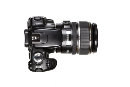Digital Single Lens Reflex Camera on white background.  photo
