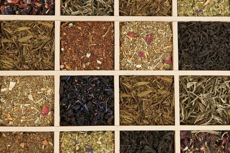 Various dry tea leaves - green, black, rooibos in wooden box. photo