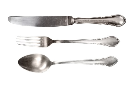 Antique silver cutlery isolated on white.