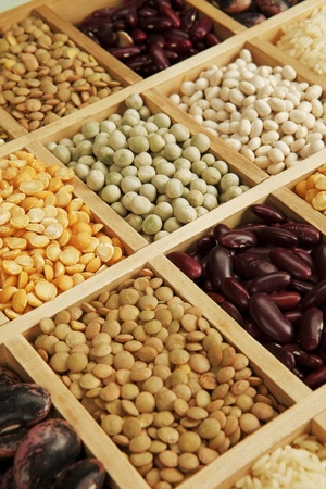 leguminous: Variation of different beans, lentils and peas in wooden box.