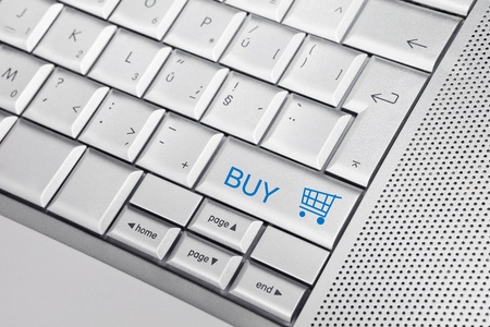Silver keyboard with shpping cart icon and text BUY on a key. Business concept Stock Photo - 8956753
