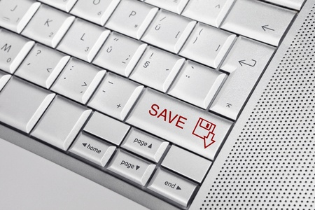 Silver keyboard with SAVE icon and SAVE text on keys. Don't forget to save your work. Stock Photo - 8956794