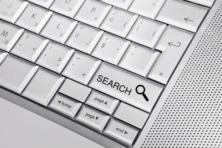 Silver keyboard with a search icon and text SEARCH on a key. Search concept. Stock Photo - 8956748