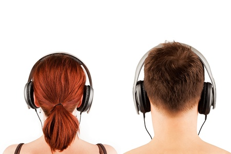 listening back: Couple with headphones isolated on white. Back view.