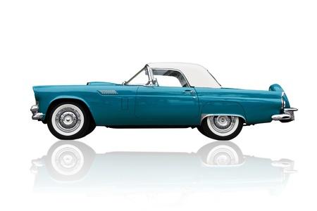 classic car: Shiny metallic old American retro car isolated on white Ford Thunder bird. Stock Photo