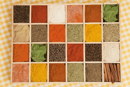 Spices collection. Various dry spices in wooden box. photo