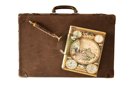 Travelling set - Retro suitcase, magnifier and world map on dark wooden background. Stock Photo - 9118302