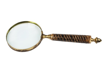 Antique magnifier isolated on white background  photo