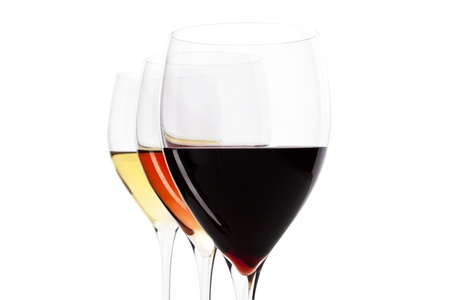 Three elegant crystal wine glasses with red, rose and white wine isolated on white background with clipping path.
