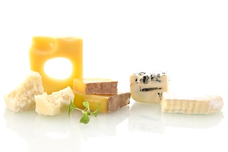 Cheese variation on white background. Emmentaler, parmesan pieces and rockford. Cheese still life.