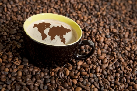 arabica: Coffee in coffee beans. World map in coffee foam.