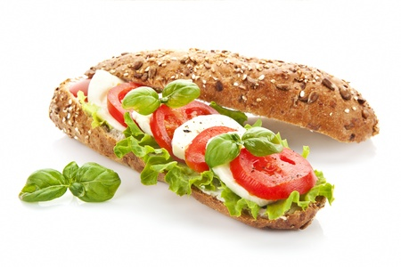 Tomato mozzarella baguette isolated on white background.  photo