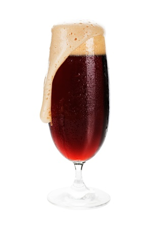 Dark beer. Full cold wet beer glass of dark beer with foam isolated on white. Stock Photo - 9733379